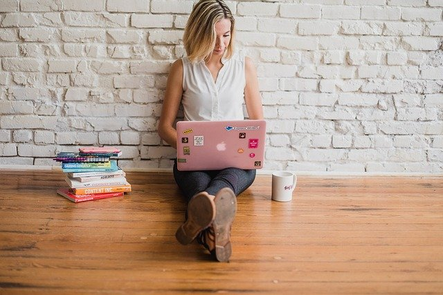a woman building her website on her laptop